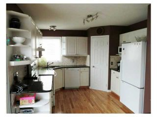 Photo 5: 52 WEST HALL Place: Cochrane Residential Detached Single Family for sale : MLS®# C3553892