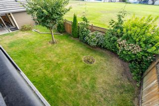Photo 57: 6868 CLEVEDON Drive in Surrey: West Newton House for sale : MLS®# R2490841