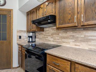 Photo 11: 107 Hawktree Bay NW in Calgary: Hawkwood Detached for sale : MLS®# A1113635