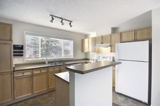 Photo 10: 25 Tuscany Springs Gardens NW in Calgary: Tuscany Row/Townhouse for sale : MLS®# A1053153