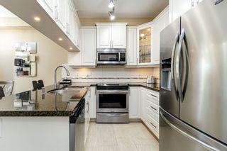 "Photo 2: 107 12635 190A Street in Pitt Meadows: Mid Meadows Condo for sale in ""CEDAR DOWNS"" : MLS®# R2353992"
