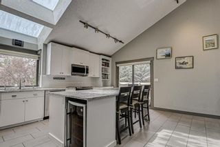 Photo 10: 512 Coach Grove Road SW in Calgary: Coach Hill Detached for sale : MLS®# A1127138