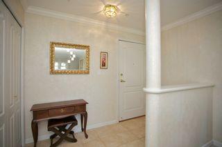 "Photo 2: 401 15340 19A Avenue in Surrey: King George Corridor Condo for sale in ""Stratford Gardens"" (South Surrey White Rock)  : MLS®# F1448318"