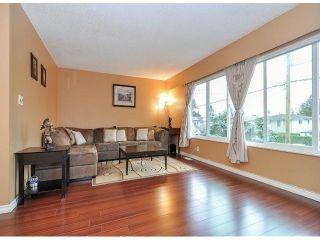 Photo 2: 1967 FRASER Avenue in Port Coquitlam: Glenwood PQ House for sale : MLS®# V1051434