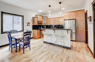 Photo 11: 1, 3421 5 Avenue NW in Calgary: Parkdale Row/Townhouse for sale : MLS®# A1057413