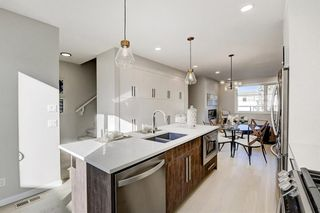 Photo 10: 2119 12 Street NW in Calgary: Capitol Hill Row/Townhouse for sale : MLS®# A1056315