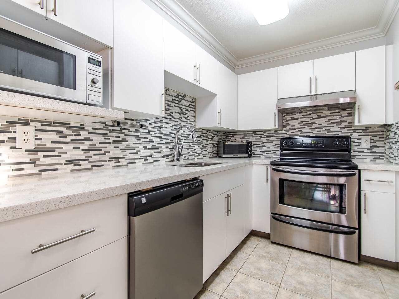 "Main Photo: 306 20561 113 Avenue in Maple Ridge: Southwest Maple Ridge Condo for sale in ""WARESLEY PLACE"" : MLS®# R2524789"