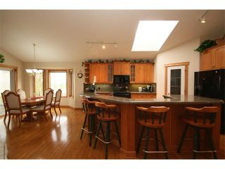 Photo 11: 315 GLENEAGLES View: Cochrane House for sale : MLS®# C4014401
