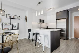 Photo 8: 1110 95 Burma Star Road SW in Calgary: Currie Barracks Apartment for sale : MLS®# A1069567
