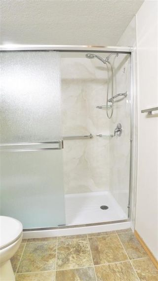 Photo 14: 407 7239 SIERRA MORENA Boulevard SW in Calgary: Signal Hill Apartment for sale : MLS®# C4303319