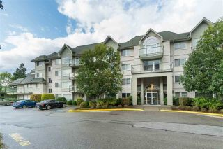"Photo 1: 108 33688 KING Road in Abbotsford: Poplar Condo for sale in ""College Park Place"" : MLS®# R2473571"