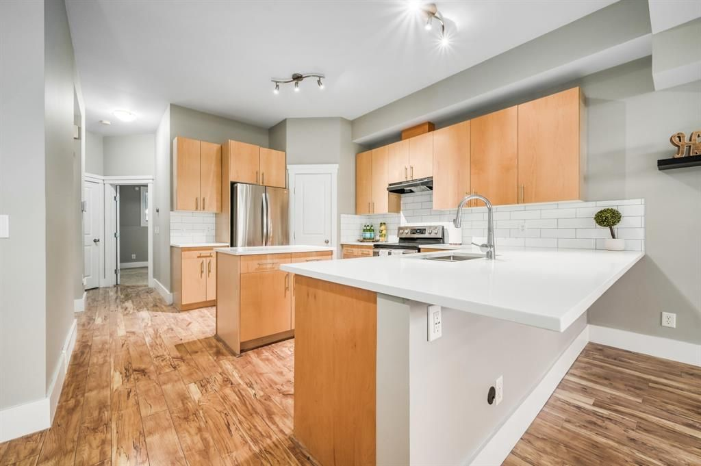 Main Photo: 2 1627 27 Avenue SW in Calgary: South Calgary Row/Townhouse for sale : MLS®# A1106108