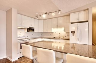 Photo 9: 509 55 ARBOUR GROVE Close NW in Calgary: Arbour Lake Apartment for sale : MLS®# A1096357