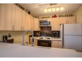 Photo 5: 869 QUEENSLAND Drive SE in CALGARY: Queensland Residential Attached for sale (Calgary)  : MLS®# C3616074