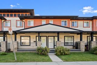 Photo 1: 38 Eversyde Common SW in Calgary: Evergreen Row/Townhouse for sale : MLS®# A1144628