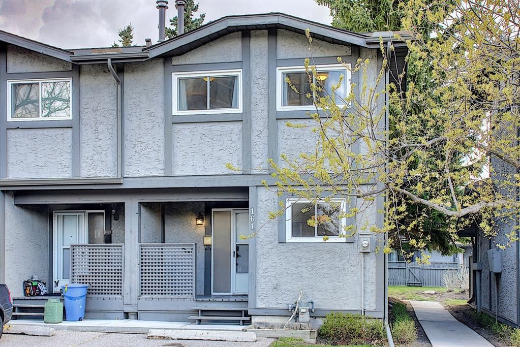 Main Photo: 161 7172 Coach Hill Road SW in Calgary: Coach Hill Row/Townhouse for sale : MLS®# A1101554