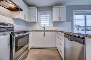 Photo 9: 129 Windstone Park SW: Airdrie Row/Townhouse for sale : MLS®# A1137155