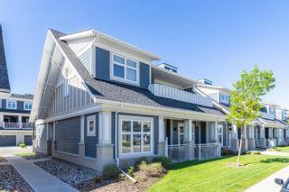 Photo 1: 168 Silverado Plains Park SW in Calgary: Silverado Row/Townhouse for sale : MLS®# A1121391