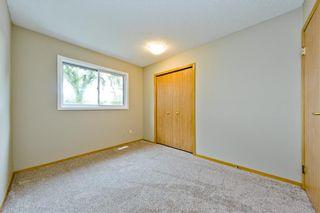 Photo 16: 132 DEER RIDGE Close SE in Calgary: Deer Ridge Semi Detached for sale : MLS®# C4303155
