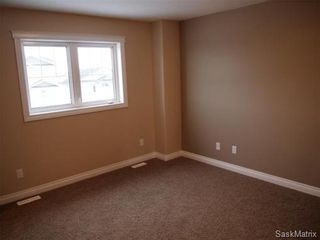 Photo 14: 211 Warwick Crescent: Warman Single Family Dwelling for sale (Saskatoon NW)  : MLS®# 434382