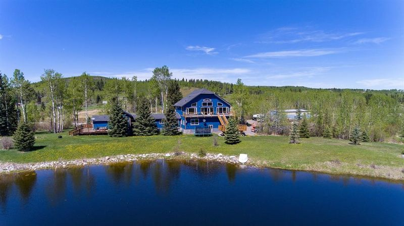 FEATURED LISTING: 336051 242 Avenue West Rural Foothills County