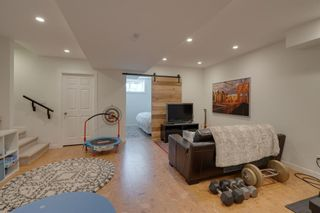 Photo 35: 52 Scarpe Drive SW in Calgary: Garrison Woods Row/Townhouse for sale : MLS®# A1128350