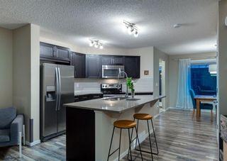 Photo 8: 40 EVANSRIDGE Court NW in Calgary: Evanston Row/Townhouse for sale : MLS®# A1095762