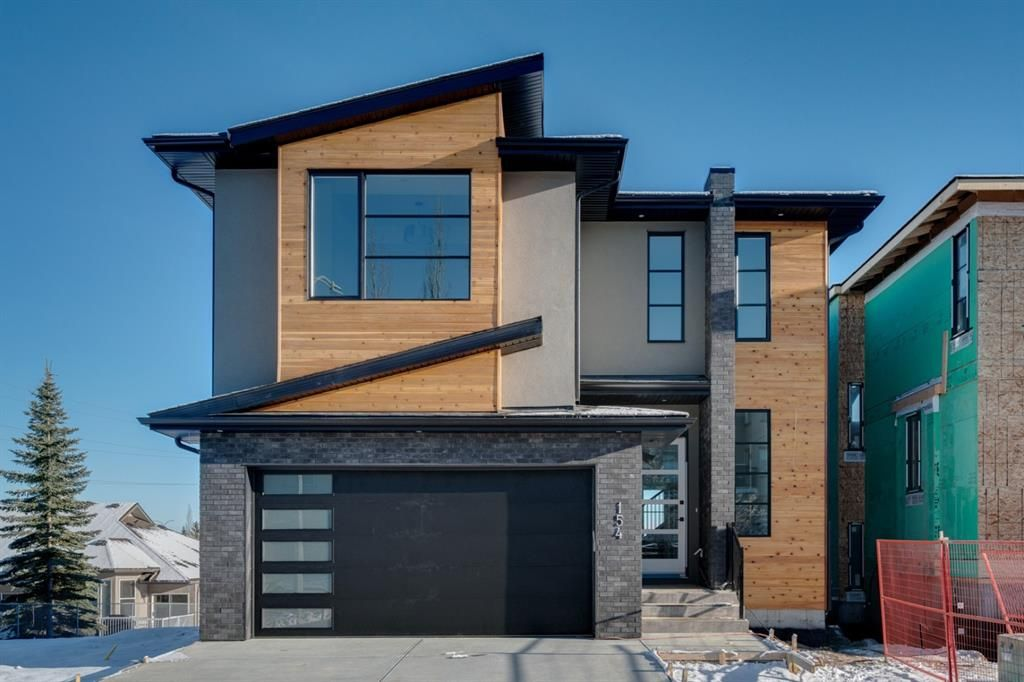 Main Photo: 154 69 Street SW in Calgary: Strathcona Park Residential for sale : MLS®# A1054727