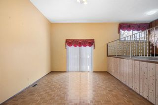 Photo 5: 128 Dovertree Place SE in Calgary: Dover Semi Detached for sale : MLS®# A1075565