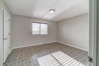 Photo 19: 4 136 Bow Ridge Drive: Cochrane Row/Townhouse for sale : MLS®# A1116097