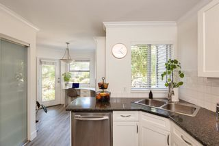 """Photo 7: 405 13900 HYLAND Road in Surrey: East Newton Townhouse for sale in """"HYLAND GROVE"""" : MLS®# R2605860"""