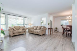 """Photo 2: 209 223 MOUNTAIN Highway in North Vancouver: Lynnmour Condo for sale in """"Mountain Village"""" : MLS®# R2588794"""