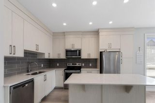 Photo 10: 903 Redstone Crescent NE in Calgary: Redstone Row/Townhouse for sale : MLS®# A1096519