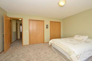 Photo 26: 41 BRIDLERIDGE Gardens SW in Calgary: Bridlewood House for sale : MLS®# C4135340