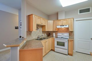 Photo 6: 1409 151 Country Village Road NE in Calgary: Country Hills Village Apartment for sale : MLS®# A1078833