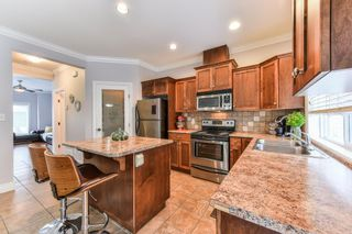 """Photo 7: 54 6498 SOUTHDOWNE Place in Sardis: Sardis East Vedder Rd Townhouse for sale in """"VILLAGE GREEN"""" : MLS®# R2340910"""