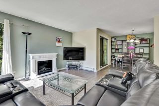 """Photo 2: 10524 HOLLY PARK Lane in Surrey: Guildford Townhouse for sale in """"Holly Park Lane"""" (North Surrey)  : MLS®# R2615553"""