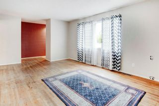 Photo 6: 411 Goddard Avenue NE in Calgary: Greenview Row/Townhouse for sale : MLS®# A1119433