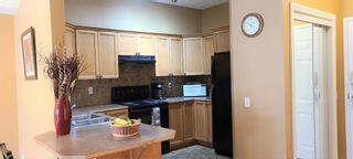 Photo 7: 106 248 Sunterra Ridge Place: Cochrane Apartment for sale : MLS®# A1097518