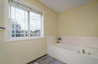 Photo 20: 85 STRATHRIDGE Close SW in Calgary: Strathcona Park Detached for sale : MLS®# A1019965