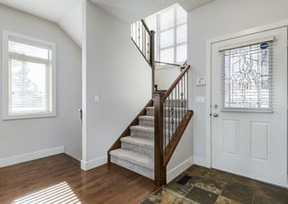 Photo 3: 106 1312 Russell Road NE in Calgary: Renfrew Row/Townhouse for sale : MLS®# A1080835