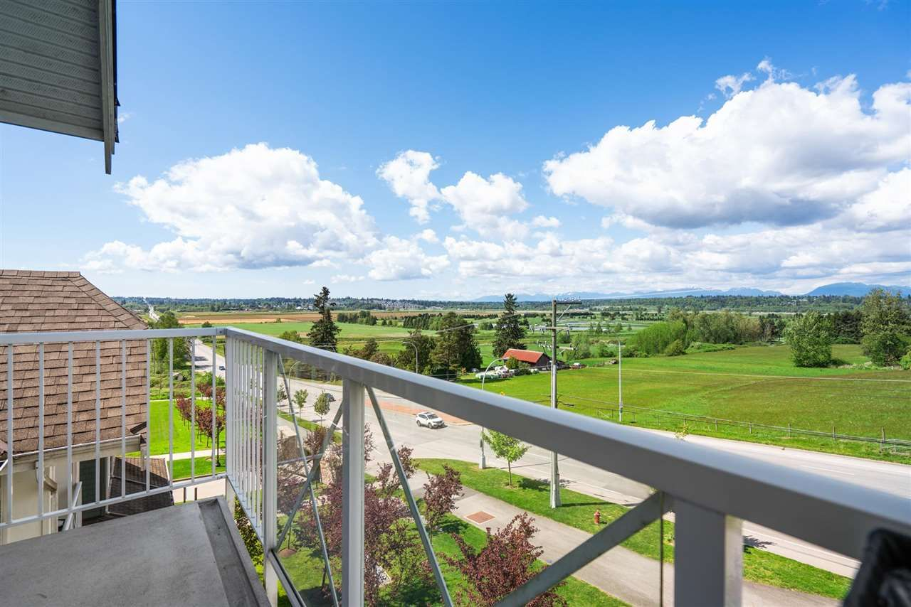 """Main Photo: 415 16398 64 Avenue in Surrey: Cloverdale BC Condo for sale in """"The Ridge at Bose Farms"""" (Cloverdale)  : MLS®# R2576898"""