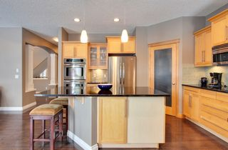 Photo 10: 131 Cougar Plateau Circle SW in Calgary: 2 Storey for sale : MLS®# C3614218
