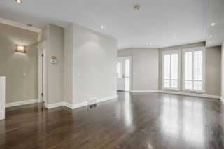 Photo 2: 1717 College Lane SW in Calgary: Lower Mount Royal Row/Townhouse for sale : MLS®# A1132774