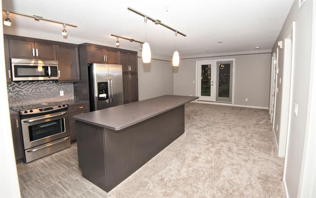 Main Photo: 1201 10 Market Boulevard SE: Airdrie Apartment for sale : MLS®# A1054465