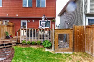 Photo 36: 43 AUBURN BAY Boulevard SE in Calgary: Auburn Bay Semi Detached for sale : MLS®# A1074651