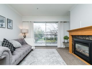 Photo 3: 211 20881 56 Avenue in Langley: Langley City Condo for sale : MLS®# R2553025