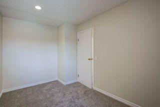 Photo 18: 305 2520 Palliser Drive SW in Calgary: Oakridge Row/Townhouse for sale : MLS®# A1101394