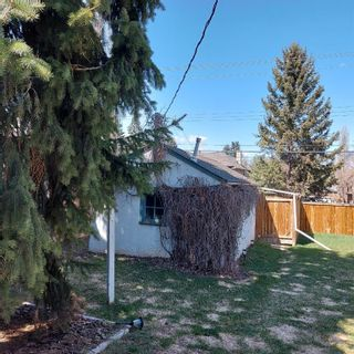 Photo 6: 208 25 Avenue NW in Calgary: Tuxedo Park Detached for sale : MLS®# A1109100