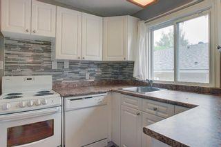 Photo 12: 236 Avonburn Road SE in Calgary: Acadia Semi Detached for sale : MLS®# A1091862